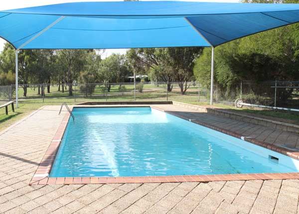 Swimming pool with shade cover